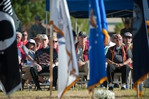 Former prisoners of war and their families watch the events of the Prisoners of War/Missing in Action Recognition Ceremony at Nellis Air Force Base, Nev., Sept. 18, 2015. During the ceremony, Airmen of Nellis AFB honored these men for their commitment and service to the nation during their time spent as POWs. (U.S. Air Force photo by Staff Sgt. Siuta B. Ika)