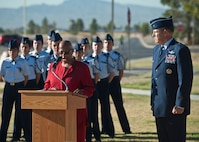 Willette Gerald, deputy director of the Nevada Department of Veterans Services, presents a proclamation from Nevada Governor Brian Sandoval to Brig. Gen. Christopher Short, 57th Wing commander, during the Prisoners of War/Missing in Action Recognition Ceremony at Nellis Air Force Base, Nev., Sept. 18, 2015. Short also spoke at the event and thanked those who came out to honor the commitment and sacrifices made by the nation's prisoners of war and those missing in action. (U.S. Air Force photo by Staff Sgt. Siuta B. Ika)