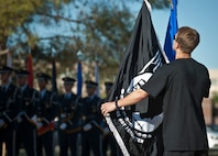 Airman Zachary Hinze, 58th Rescue Squadron pararescueman, delivers the Prisoners of War/Missing in Action Flag to the POW/MIA Recognition Ceremony at Nellis Air Force Base, Nev., Sept. 18, 2015. Hinze was part of a group of 58th/66th RQS and the U.S. Air Force Weapons School members who ran a combined 89 miles with the flag before delivering it to the ceremony. (U.S. Air Force photo by Staff Sgt. Siuta B. Ika)