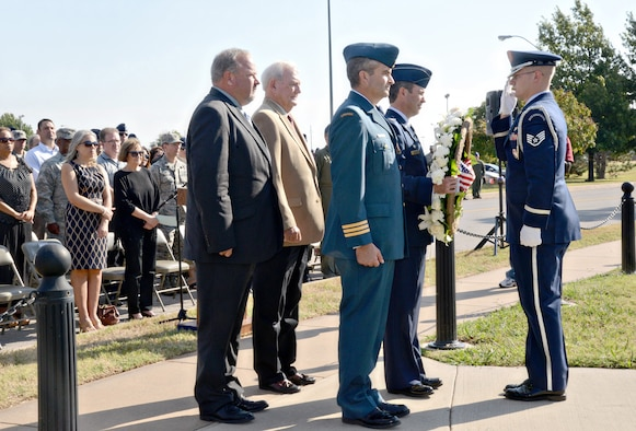 "During a Sept. 22 ceremony, Col. David Gaedecke, 552nd Air Control Wing commander, receives a wreath from a member of Tinker's Honor Guard to place at the foot of the Yukla 27 Memorial. Assisting with the wreath laying are, from left, retired Master Sgt. Ken Lybolt, who was the crew chief for the Yukla; retired Col. Wylie Koiner, former 552nd ACW commander; and Lt. Col. Don ""Boc"" Saunders, Canadian Detachment commander. The ceremony marked the 20th anniversary of ""Yukla two-seven"" crashing 42 seconds after takeoff at Elmendorf Air Force Base, Alaska, killing all 24 crew members onboard. (Air Force photo by Kelly White/Released)"