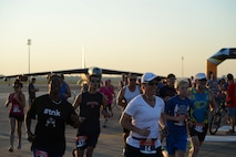 Runners begin the 2015 Half Marathon and 5K, hosted by the 2nd Force Support Squadron, on the flightline at Barksdale Air Force Base, La., Sept. 19, 2015. Nearly 300 participants from on and off base, including runners aged 9-69, as well as kids on bikes and others towed in strollers and wagons, joined to race. (U.S. Air Force photo/Tech. Sgt. Thomas Trower)