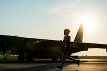 The son of Maj. Christopher Miser, 608th Air Operations Center, crosses the taxiway on the flightline at Barksdale Air Force Base, La., Sept. 19, 2015, during the annual 2015 Half Marathon and 5K hosted by the 2nd Force Support Squadron. As the youngest runner, he placed first in his age group in the half marathon with a time of 1:56:51. (U.S. Air Force photo/Staff Sgt. Tyler Prince)