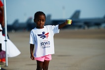Daughter of Tech. Sgts. Shanaysha and Edwin Evans of the 2nd Force Support Squadron and Air Force Global Strike Command, works a water station for runners crossing the taxiway on the flightline at Barksdale Air Force Base, La., Sept. 19, 2015. The 2nd  FSS hosted the 2015 Half Marathon and 5K to build relationships between the on and off base communities. (U.S. Air Force photo/Tech. Sgt. Thomas Trower)