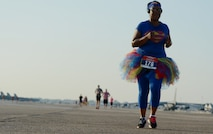 Angel Kaylor crosses the taxiway on the flightline at Barksdale Air Force Base, La., Sept. 19, 2015, during the 2015 Half Marathon and 5K hosted by the 2nd Force Support Squadron. Nearly 300 participants from on and off base, including runners aged 9-69, as well as kids on bikes and others towed in strollers and wagons, joined to race. (U.S. Air Force photo/Tech. Sgt. Thomas Trower)
