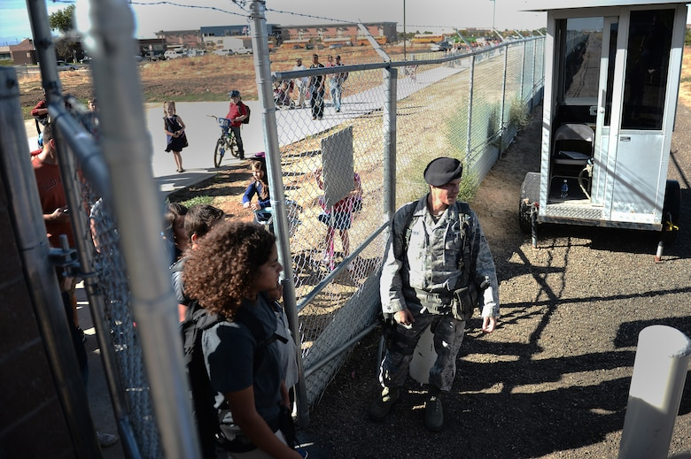 Children line up at the new pedestrian gate on their way home from school Sept. 21, 2015, on Buckley Air Force Base, Colo. The new pedestrian gate benefits families on Buckley AFB by significantly cutting down travel time to get to the P-8 school across the street.