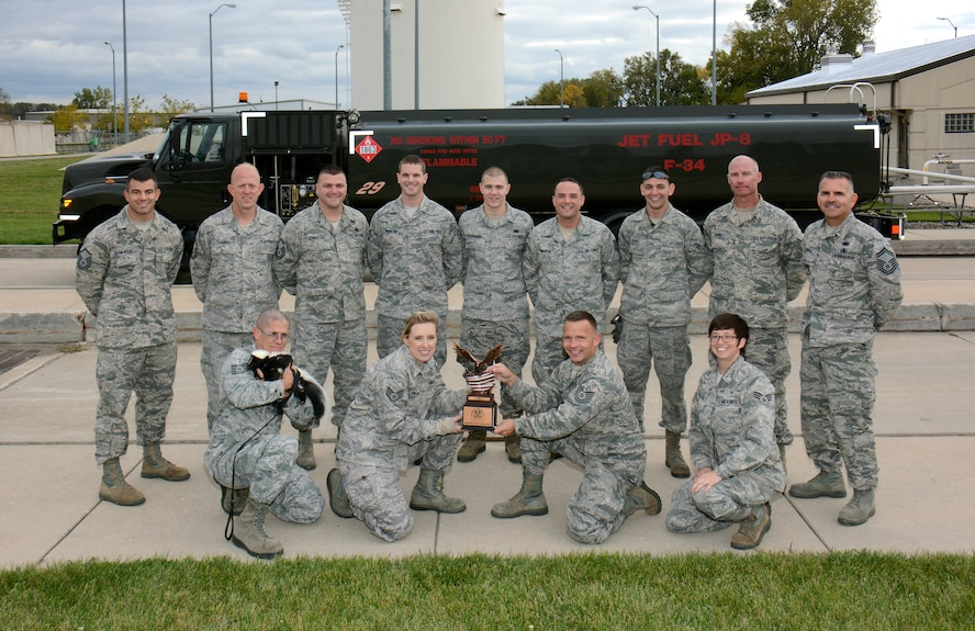 "Members of the 115th Fighter Wing Fuels Management Flight pose after being presented the 2014 ""Work Center of the Year"" award in Madison, Wis., on Oct. 4, 2014.  The section distinguished itself through superior performance in supporting the 115 FW 24/7 Aerospace Control Alert missions, combat training flying operations, and two deployments to Volk Field, Wisconsin, and Red Flag, Alaska, during fiscal year 2014. (Air National Guard photo by Master Sgt. Paul Gorman)"