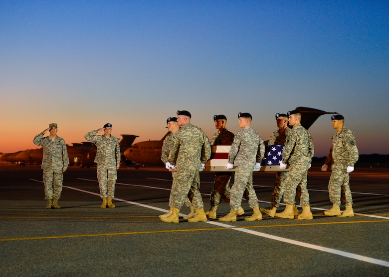 A U.S. Army carry team transfers the remains of Spc. Kyle E. Gilbert of Buford, Ga., at Dover Air Force Base, Del.  Buford was assigned to 2nd Battalion, 14th Infantry Regiment, 2nd Brigade Combat Team, 10th Mountain Division, Fort Drum, New York. (U.S. Air Force photo/Senior Airman William Johnson)