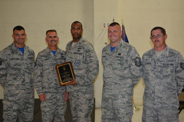 Members of the 115th Fighter Wing Fuels Management Flight pose after being presented the 2014 American Petroleum Institute award in Madison, Wis., on Sept. 3, 2015.  The section distinguished itself through superior performance in supporting the 115 FW 24/7 Aerospace Control Alert missions, combat training flying operations, and two deployments to Volk Field, Wisconsin, and Red Flag, Alaska, during fiscal year 2014. (Air National Guard photo by Capt. Kristin K. Boustany/Released)