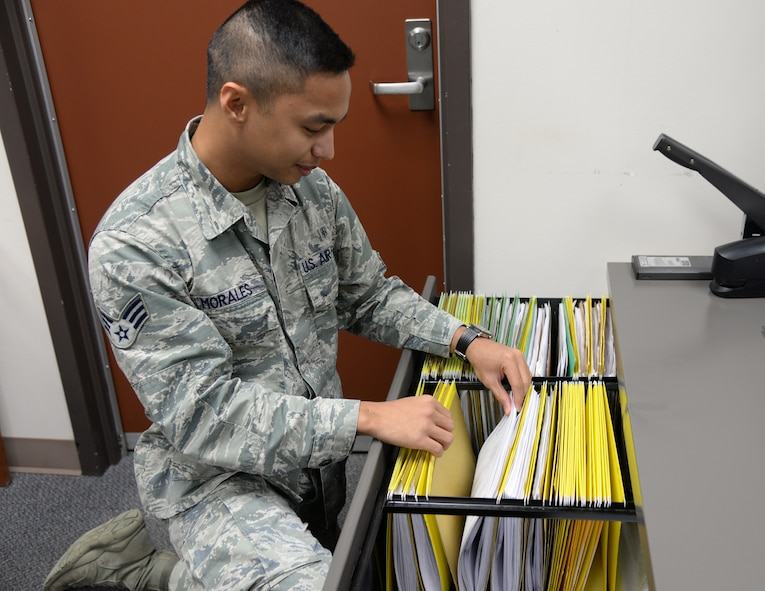 U.S. Air Force Senior Airman Noel Morales, a 354th Medical Support Squadron uniform business office manager, searches through vouchers Sept. 23, 2015, at Eielson Air Force Base, Alaska. Morales files collection vouchers and deposit slips that are kept for audit purposes. (U.S. Air Force photo by Airman 1st Class Cassandra Whitman/Released)