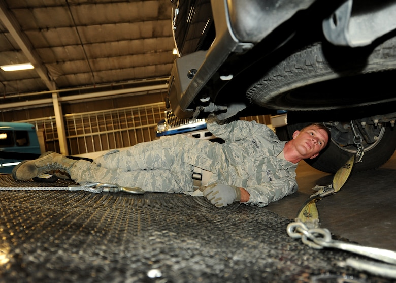 Senior Airman Charles Farber, 319th Logistics Readiness Squadron vehicle operations journeyman, hooks up a truck to a tow line Sept. 17, 2015, on Grand Forks Air Force Base, North Dakota. Farber was selected as the Warrior of the Week for the fourth week of September 2015. (U.S. Air Force photo by Airman 1st Class Ryan Sparks/Released)