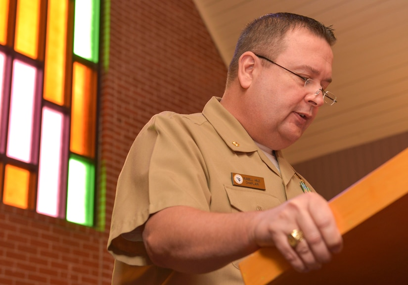 During the Navy Gold Star Remembrance ceremony, Navy Lieutenant Commander Russell Hale, Navy Chaplain, speaks to the congregation at the Good Shepherd Chapel Sept. 23, 2015 on Joint Base Charleston –Weapons Station, Charleston, S.C. The Navy Gold Star Remembrance event honored local deceased Sailors.