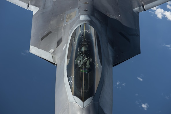 A U.S. Air Force F-22 Raptor pilot from the 95th Fighter Squadron, Tyndall Air Force Base, Fla., flies over the Baltic Sea Sept. 4, 2015. The U.S. Air Force has deployed four F-22 Raptors, one C-17 Globemaster III, approximately 60 Airmen and associated equipment to Spangdahlem Air Base, Germany. While these aircraft and Airmen are in Europe, they will conduct air training with other Europe-based aircraft. (U.S. Air Force photo by Tech. Sgt. Jason Robertson/Released)