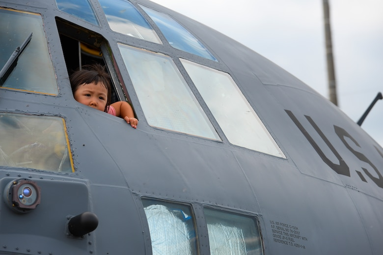 A child looks out the window of a C-130 Hercules during the Japanese-American friendship festival at Yokota Air Base, Japan, Sept. 20, 2015. Yokota invited visitors to explore the inside of some of the aircraft on display at the festival. (U.S. Air Force photo/Airman 1st Class Elizabeth Baker)