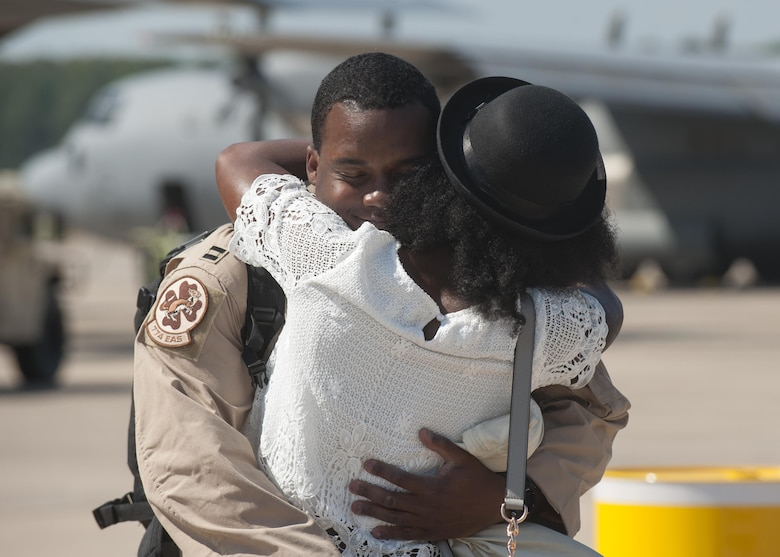 Capt. Boston McClain, a 61st Airlift Squadron co-pilot, embraces his wife after returning from deployment Sept. 15, 2015, at Little Rock Air Force Base, Ark. Little Rock AFB Airmen specialize in combat airlift and expeditionary support downrange. (U.S. Air Force photo/Senior Airman Scott Poe)