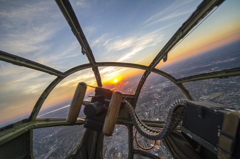 "A sunset is seen through the nose of a B-25 Mitchell during a military tattoo held at Joint Base Anacostia-Bolling in Washington, Sept. 16, 2015. The ""warbird flight"" consisted of two B-25 Mitchells, two P-40 Warhawks and a P-51 Mustang. (U.S. Air Force photo/Airman 1st Class Ryan J. Sonnier)"