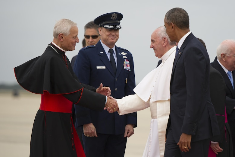 Pope Francis, escorted by President Barack Obama, greets Cardinal Donald W. Wuerl, the archbishop of Washington, and Maj. Gen. Darryl Burke, the Air Force District of Washington commander, at Joint Base Andrews, Md., Sept. 22, 2015. This marked the first visit by the current pope to the United States. (U.S. Air Force photo/Tech. Sgt. Robert Cloys)