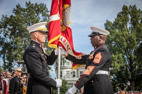 The 18th Sergeant Major of the Marine Corps, Ronald L. Green, right, delivers the Battle Colors to the 36th Commandant of the Marine Corps, Gen. Joseph F. Dunford Jr., at Marine Barracks Washington, D.C., Sept. 24, 2015. Gen. Robert B. Neller took command from Dunford during the Passage of Command Ceremony. (U.S. Marine Corps photo by Sgt. Melissa Marnell, Office of the Sergeant Major of the Marine Corps/Released)