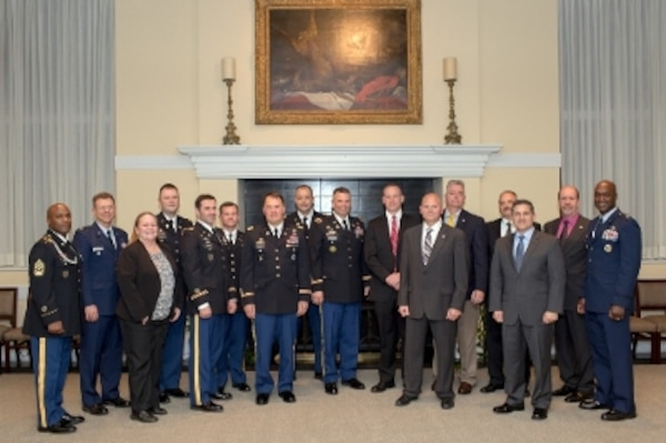 Laird, seventh from right, poses with the 2015 Depot and Arsenal Executive Leadership Program graduates.