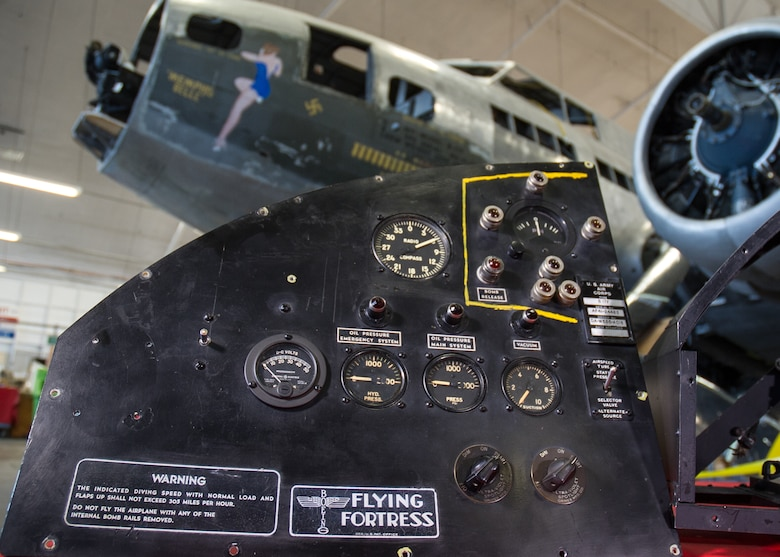 "DAYTON, Ohio -- The B-17F ""Memphis Belle"" and the pilot's instrument panel in the restoration hangar at the National Museum of the United States Air Force. (U.S. Air Force photo)"