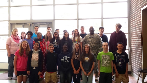 Defense Logistics Agency Distribution commander Army Brig. Gen. Richard Dix volunteers with the Junior Achievement Program of Central Pennsylvania at New Cumberland Middle School.