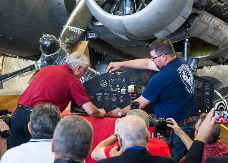 DAYTON, Ohio -- Museum Restoration staff install the pilot's instrument panel donated by officials from the National Museum of the Mighty Eighth Air Force in the restoration hangar at the National Museum of the United States Air Force. (U.S. Air Force photo)