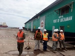 Officer in Charge United States Marine Corps Maj. John Simpson, far left, at the port of Buchanan in Liberia.