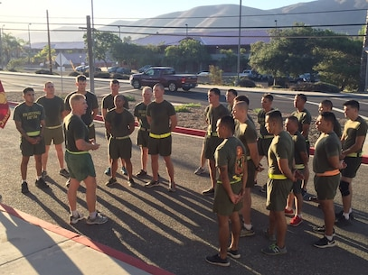 Camp San Mateo-Colonel K.R. Kassner, Commanding Officer of the Fighting Fifth Marine Regiment is addressing the group of selected Sergeants within the regiment upon completion of the Committed and Engaged Leaders Physical Training session.
