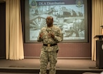 DLA Distribution commander Army Brig. Gen. Richard Dix discusses the achievements of the award winners at the June 25 town hall.