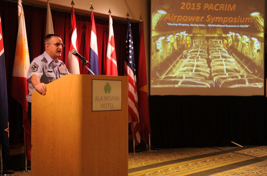 Chief MasterSgt. Buddy Hutchison, Pacific Air Forces command chief, engages in a discussion on senior enlisted development with attendees of the Pacific Rim Airpower Symposium Sept. 22, 2015, in Honolulu, Hawaii. Senior officer and enlisted airmen from nations throughout the Indo-Asia-Pacific region attended the symposium to discuss ways to improve cooperation, leadership and coordination efforts. (U.S. Air Force photo by Staff Sgt. Alexander Martinez/Released)