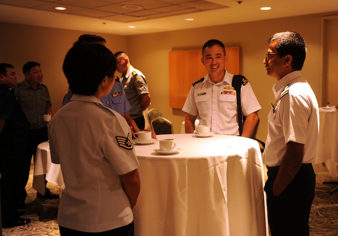 U.S. and multinational airmen speak with each other during a break in discussion sessions at the Pacific Rim Airpower Symposium Sept. 22, 2015, in Honolulu, Hawaii. Senior officer and enlisted airmen from nations throughout the Indo-Asia-Pacific region attended the symposium to discuss ways to improve cooperation, leadership and coordination efforts. (U.S. Air Force photo by Staff Sgt. Alexander Martinez/Released)