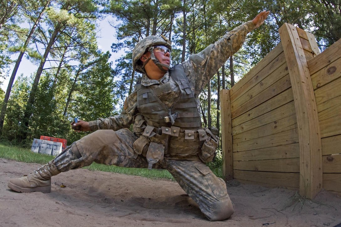 Army Pvt. Joshua Finau aims before throwing a hand grenade during basic training on Fort Jackson, S.C., Sept. 19, 2015. U.S. Army photo by Sgt. Ken Scar