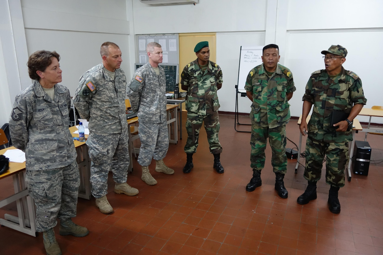 U.S Air Force Master Sgt. Lori Hoop, Army Master Sgt. Marcus Frey and Army Staff Sgt. Richard Watkins, all members of the South Dakota National Guard, participate in a subject matter expert exchange on non-commissioned officer professional development in Paramaribo, Suriname, Sept. 16, 2015.