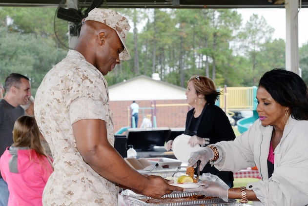 "Marine Corps Logistics Base Albany's Marine and Family Programs hosts the first Front Porch Community Fair Sept. 24 at Boyett Park. Service members and families gathered during a ""Fun-4-All"" occasion, which included games, music, food, arts and crafts, door prizes and booths sponsored by community volunteer organizations. The event also featured a special guest book signing, storytelling and puppet show by Dr. Georgella Wright, author of ""My Daddy the United States Marine."" The fair drew more than 200 people."