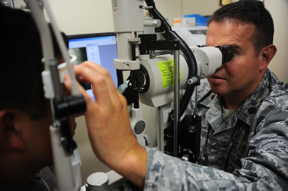 Maj. Oscar Corredor, Aerospace Medicine Flight Commander, exams a patients eye Sept. 22 at the Columbus Air Force Base medical clinic. The optometry clinic is well equipped with the latest technology to fully assess the health of the visual system. (U.S. Air Force photo/Airman 1st Class Daniel Lile)