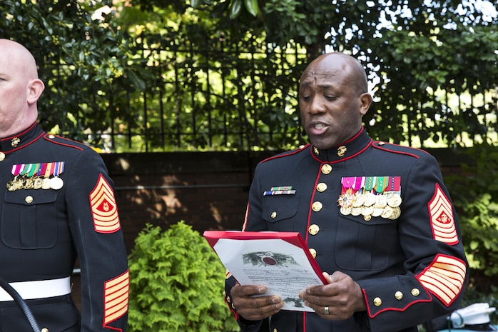 Sergeant Major of the Marine Corps Ronald L. Green reads a promotion warrant during Gen. Robert B. Neller's promotion ceremony at Marine Barracks Washington, D.C., Sept. 24, 2015. Neller was promoted from the rank of lieutenant general to general in the Marine Corps. (U.S. Marine Corps photo by Sgt. Gabriela Garcia/Released)