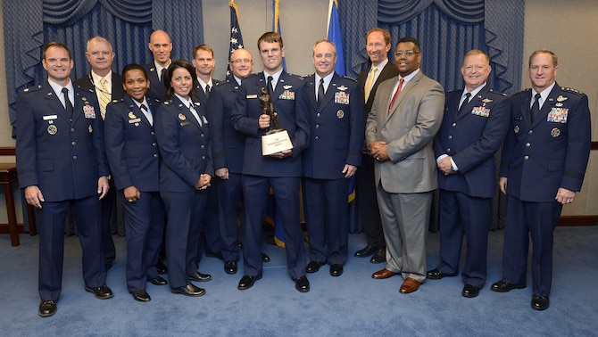 Members of the Air Force Safety program stand with Capt. Timothy Killham (center), an F-35 Lightning II pilot from the 33rd Flying Training Squadron at Eglin Air Force Base, Fla., after he received the Koren Kolligian trophy during a Pentagon ceremony Sept. 23, 2015. The Kolligian Award recognizes outstanding airmanship by an aircrew member and is named after 1st Lt. Koren Kolligian, who went missing while piloting his T-33 aircraft off the coast of California.  (U.S. Air Force photo/Scott M. Ash)