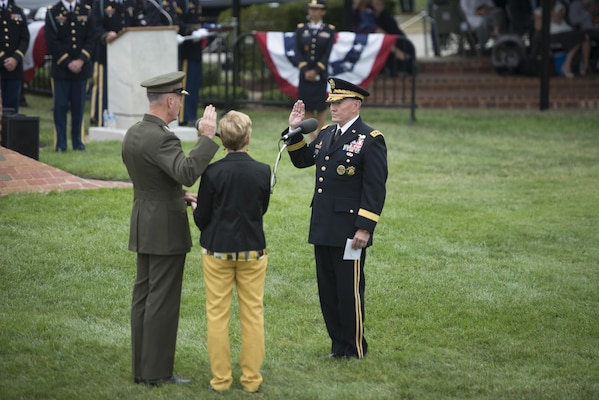 The 18th Chairman of the Joint Chiefs of Staff U.S. Army Gen. Martin E. Dempsey swears in 19th Chairman of the Joint Chiefs of Staff U.S. Marine Corps General Joseph Dunford during Dempsey's retirement ceremony and change of responsibility ceremony. Dempsey retires from the military after 41 years in service, and is succeeded by Marine Gen. Joseph Dunford. The ceremony took place at Joint Base Myer-Henderson Hall in Washington, D.C., Sept. 25, 2015.