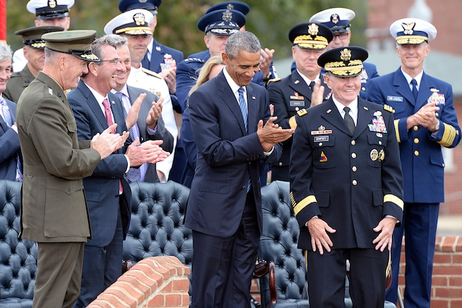 President Barack Obama, Secretary of Defense Ash Carter and Marine Gen. Joseph F. Dunford Jr., the new chairman, applaud outgoing Chairman of the Joint Chiefs of Staff Army Gen. Martin E. Dempsey during the change of responsibility ceremony at Summerall Field, Joint Base Myer-Henderson Hall, Arlington, Va., Sept. 25, 2015. DoD photo by U.S. Army Sgt. 1st Class Clydell Kinchen