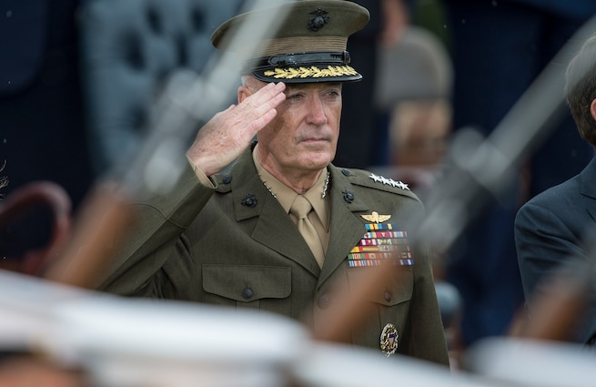 Marine Gen. Joseph Dunford, 19th chairman of the Joint Chiefs of Staff, salutes during a passing review during Army Gen. Martin E. Dempsey, 18th chairman of the Joint Chiefs of Staff's retirement and change of responsibility ceremony, on Summerall Field, Joint Base Myer-Henderson Hall, Arlington, Va., Sept. 25, 2015. DoD photo by Navy Petty Officer 2nd Class Dominique A. Pineiro