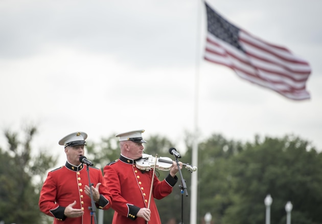 """Members of the U.S. Army Band """"Pershing's Own"""" perform at the retirement and change of responsibility ceremony for the 18th Chairman of the Joint Chiefs of Staff U.S. Army Gen. Martin E. Dempsey at Joint Base Myer-Henderson Hall in Washington, D.C., Sept. 25, 2015. Dempsey retires from the military after 41 years in service. DoD photo by Petty Officer 2nd Class Dominique A. Pineiro"""