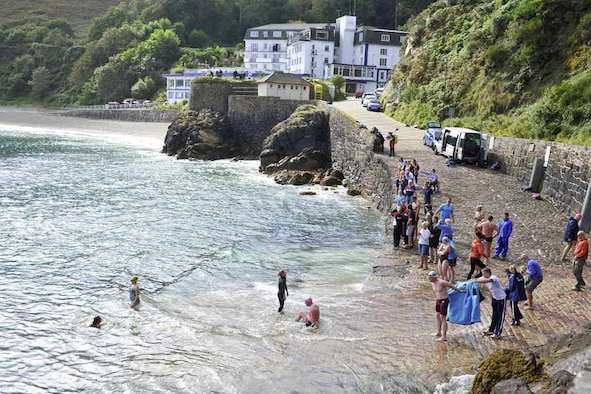 The round island swim was moved to the sheltered waters of Bouley Bay due to high winds and unfavorable swimming conditions.  USAF photo by Tony Pike
