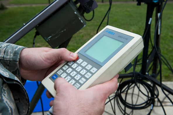 U.S. Air Force Airman 1st Class Lucas Payne, 23d Operations Support Squadron weather technician, uses a handheld display for observing weather Sept. 21, 2015, at Moody Air Force Base, Ga. The handheld display connects to a meteorological observing system that provides the weather forecast. (U.S. Air Force photo by Airman 1st Class Kathleen D. Bryant/Released)