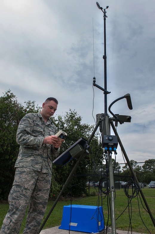 U.S. Air Force Airman 1st Class Lucas Payne, 23d Operations Support Squadron weather technician, uses the weather flight's meteorological observing system Sept. 21, 2015, at Moody Air Force Base, Ga. Weather technicians use this equipment when the automated sensor on the flightline fails. (U.S. Air Force photo by Airman 1st Class Kathleen D. Bryant/Released)