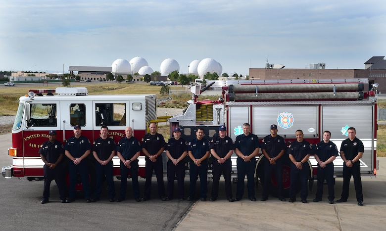 The Buckley Fire Department poses for a photograph Sept. 22, 2015, on Buckley Air Force Base, Colo. The fire department was recently given permission by Air Force officials to resume the use of paramedics on base, cutting response times in half and allowing fire department personnel to use their capabilities to the fullest. (U.S. Air Force photo by Airman 1st Class Luke W. Nowakowski/Released)