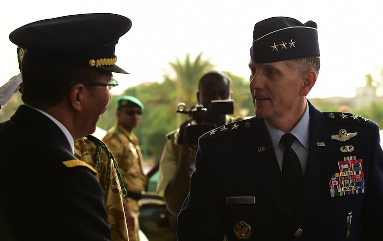 Mauritanian Air Force Chief of Staff Col. Mohamed Lehreitani greets U.S. 17th Expeditionary Air Force Commander Lt. Gen. Timothy Ray as he arrives at the Palais des Congres for the opening ceremony of the 5th Annual African Air Chiefs Symposium in Nouakchott, Mauritania, Sept. 15, 2015. The Mauritanian Air Force is co-hosting this year's African Air Chiefs Symposium along-side U.S. Air Forces Africa Sept. 14-17.  The event gives Air Chiefs from the U.S. and 18 African countries the chance to discuss the role of Air Power in addressing African challenges. (U.S. Air Force photo by Master Sgt. Chrissy Best/Released)