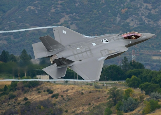 Lt. Col. George Watkins, the 34th Fighter Squadron commander, flies a combat-coded F-35A Lightning II aircraft past the control tower at Hill Air Force Base, Utah, Sept. 17, 2015. During the sortie, the base's first, Watkins conducted mission qualification training focusing on weapons employment, range familiarization and mission system proficiency. (U.S. Air Force photo/Alex R. Lloyd)