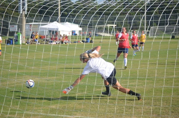 Alyson Gleason lunges in an attempt to stop a goal by Kate Herren during women's Armed Forces soccer camp last week at MacDill Air Force Base, Fla. Gleason is headed to compete for the USA at the Military World Games in Korea next week. (Photo by Kevin Davalos)