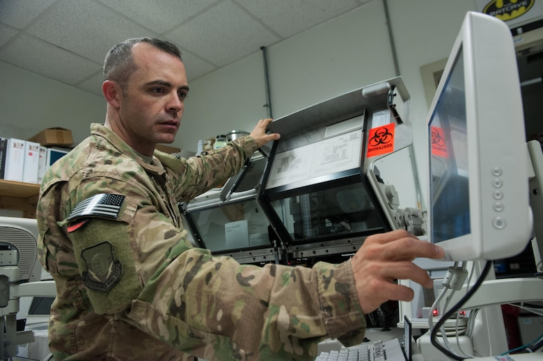 U.S. Air Force Tech. Sgt. Scott Hatch, 455th Expeditionary Medical Group biomedical equipment technician and Craig Joint Theater Hospital facility manager, performs maintenance on a blood testing machine at Bagram Airfield, Afghanistan, Sept. 24, 2015. (U.S. Air Force photo by Tech. Sgt. Joseph Swafford/Released)