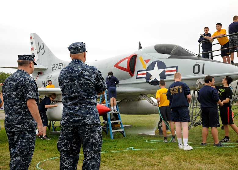 Sea Cadets from the Tomcat squadron, wash an A-4B Skyhawk at the Selfridge