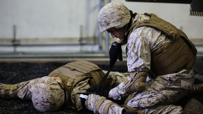A Marine with 2nd Supply Battalion, Combat Logistics Regiment 25, applies a tourniquet to a simulated casualty at Marine Corps Base Camp Lejeune, North Carolina, Sept. 23, 2015. The battalion conducted the training, which simulates vehicle rollovers and how to react, in order to hone their skills prior to deploying.